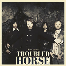 STEP INSIDE/TROUBLED HORSE